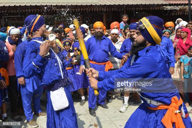 Indian Sikh youth perform Sikh martial arts known as 'Gatka' during a procession from the 'Sri Akal Takhat Sahib' at the Sikh Shrine The Golden...