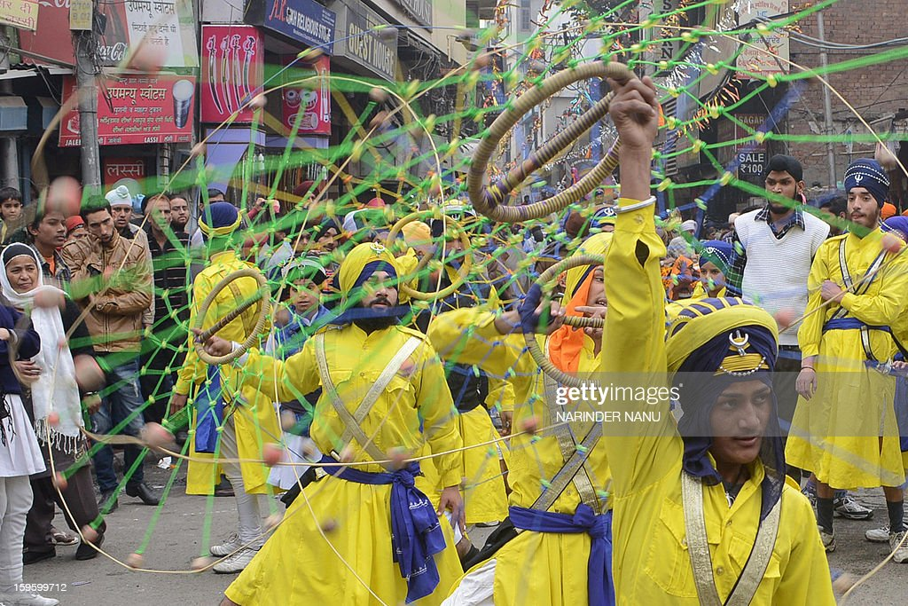 Indian Sikh youths demonstrate their gatka martial arts skills during a procession in Amritsar on January 17, 2013. The procession took place on the eve of 348th Birth Anniversary of 10th Sikh Guru Gobind Singh .