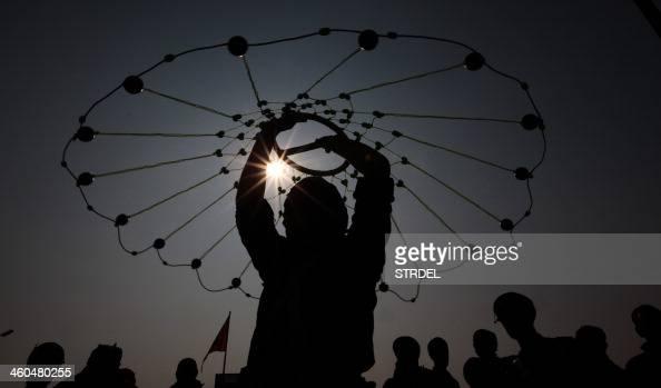 Indian Sikhs demonstrate their Gatka martial arts skills during 'Nagar Kirtan' a religious procession in Jammu on January 4 part of 'Prakash Utsav'...