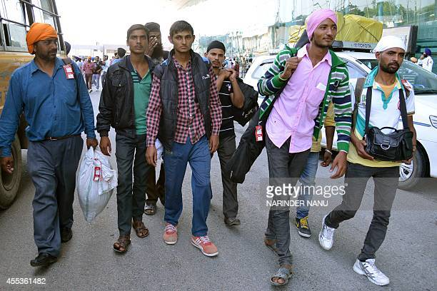 Indian Sikhs evacuated from flooding in Srinagar arrive at the airport in Amritsar on September 13 2014 Some 47 minority Sikhs rescued during floods...