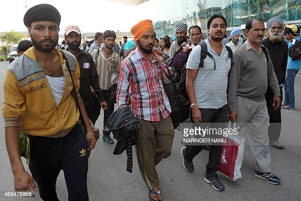 Indian Sikhs evacuated from flooding in Srinagar arrive at the airport in Amritsar on September 15 2014 Some 88 minority Sikhs rescued during floods...