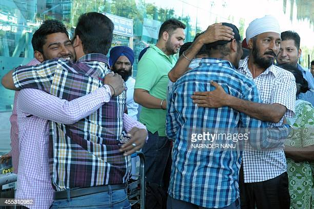 Indian Sikhs evacuated from flooding in Srinagar greets relatives following their arrival at the airport in Amritsar on September 12 2014 Some 30...