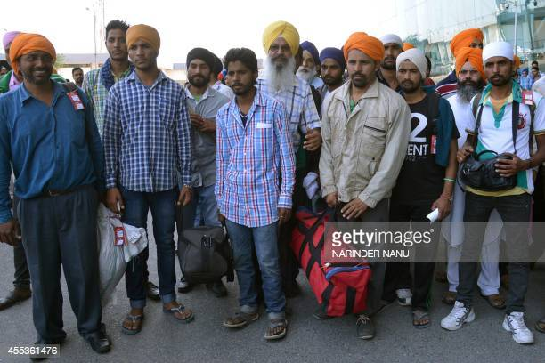 Indian Sikhs evacuated from flooding in Srinagar wait for a bus after arriving at the airport in Amritsar on September 13 2014 Some 47 minority Sikhs...