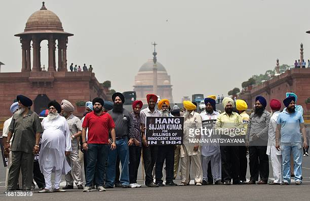 Indian Sikhs shout antigovernment slogans during a demonstration against the acquittal of Congress politician Sajjan Kumar outside the Parliament in...