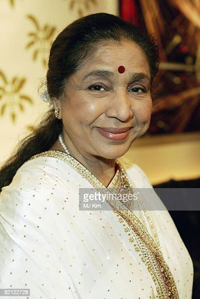 Indian singer Asha Bhosle pose at a photocall ahead of tomorrow's 'MTV Asia Aid' at the Met Bar of The Metroplitan Hotel on February 2 2005 in...