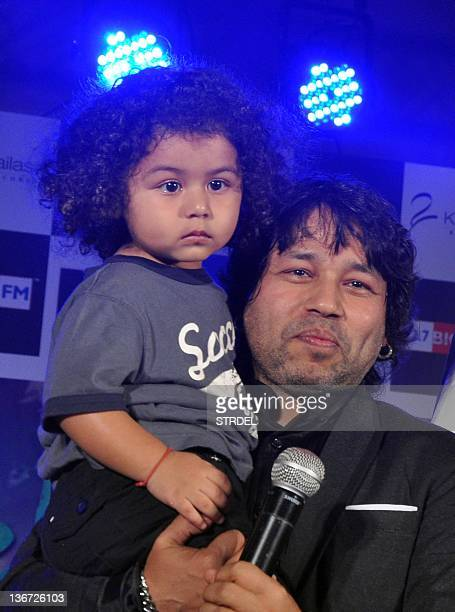 "Indian singer Kailash Kher poses with his son during the release of his new album ""Kailasha Rangeele"" in Mumbai on January 10 2012 AFP PHOTO / STR"