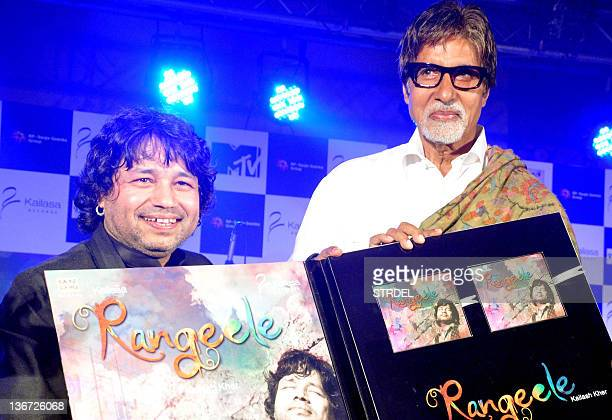 "Indian singer Kailash Kher poses with Indian Bollywood actor Amitabh Bachchan during the release of his new album ""Kailasha Rangeele"" in Mumbai on..."