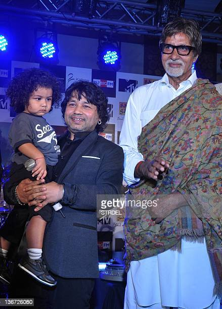 "Indian singer Kailash Kher with son Kabir Kher poses with Indian Bollywood actor Amitabh Bachchan during the release of his new album ""Kailasha..."