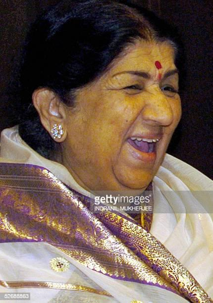 Indian singer Lata Mangeshkar laughs during the annual Pundit Dinanath Mangeshkar Memorial award function in Bombay 24 April 2005 The memorial awards...