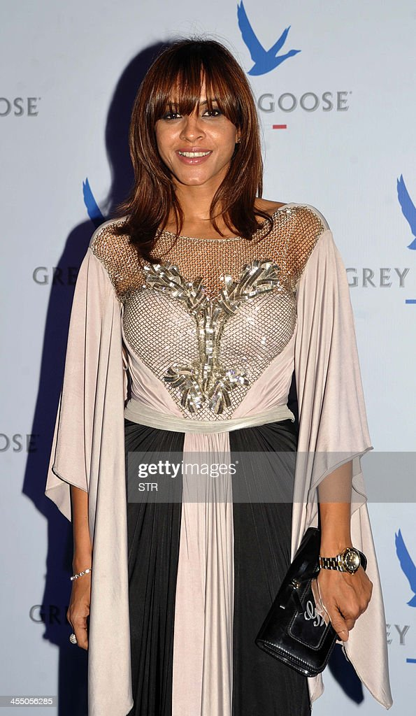 Indian singer Manasi Scott poses at the 'Grey Goose Style Du Jour' Spring-Summer collection fashion show in Mumbai on December 10, 2013.