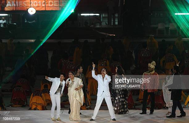 Indian singers Shaan Usha Uthup perform onstage with other Indian artistes during the Commonwealth Games closing ceremony at the Jawaharlal Nehru...