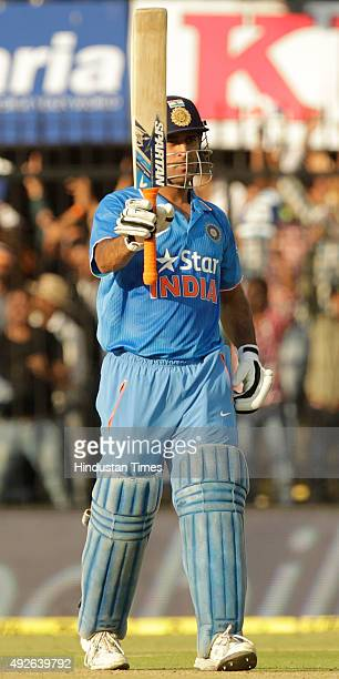 Indian skipper MS Dhoni celebrates his half century during the 2nd One Day cricket match against South Africa at Ushabai Holkar Stadium on October 14...