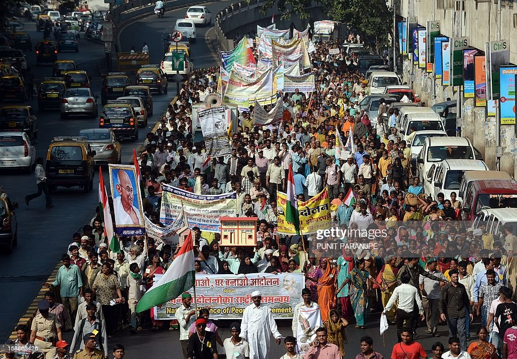 Indian slum dwellers march during a protest rally in Mumbai on January 2, 2013. Around two thousand slum dwellers took part in the protest to demand housing rights for the poor from the government. AFP PHOTO/ PUNIT PARANJPE