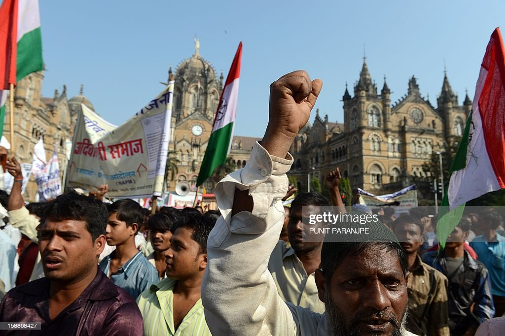 Indian slum dwellers shout slogans during a protest rally in Mumbai on January 2, 2013. Around two thousand slum dwellers took part in the protest to demand housing rights for the poor from the government.
