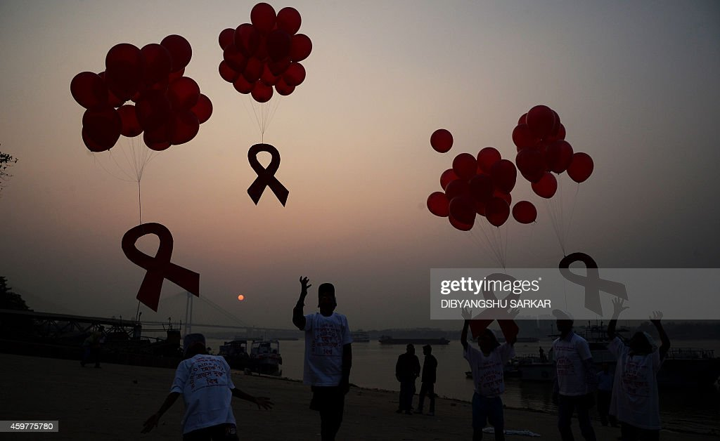 Indian social activists and children release ribbons and balloons during an event to mark World AIDS Day in Kolkata on December 1 2014 According to...
