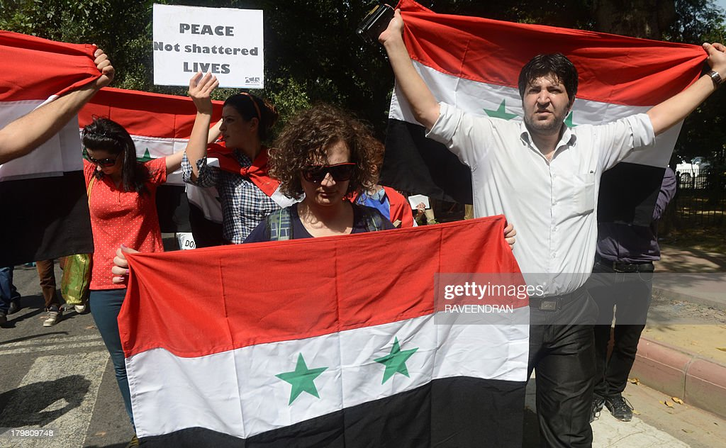 Indian social activists, college students and Syria supporters hold placards and banners as they march to US Embassy in New Delhi on September 7, 2013, against possible US strikes against Syria. As well as the stubborn international differences, the US administration is still scrambling to win backing from Congress for any action against Syria.