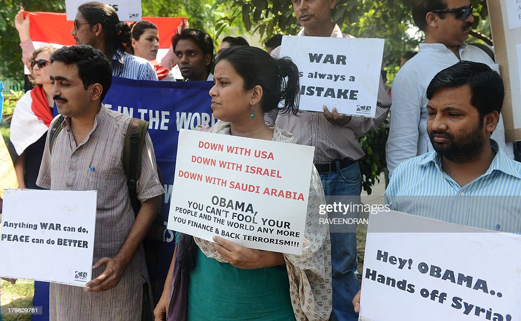 Indian social activists, college students and Syria supporters hold placards and banners as they protests near the US Embassy in New Delhi on September 7, 2013, against possible US strikes against Syria. As well as the stubborn international differences, the US administration is still scrambling to win backing from Congress for any action against Syria.