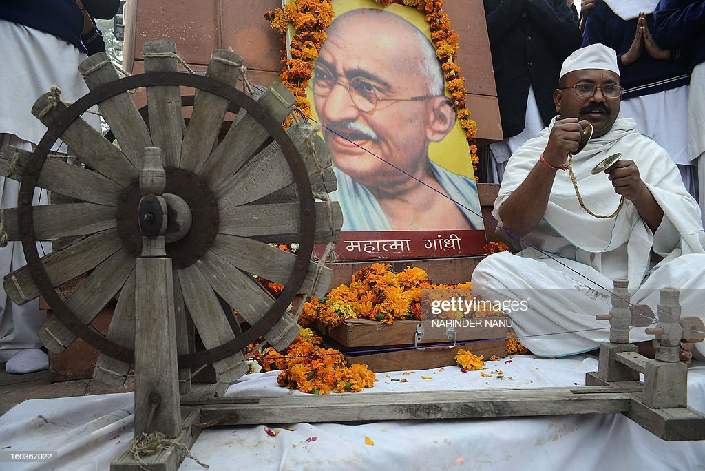 Indian social worker Sham Lal Gandhi pays his respects on the occasion of Martyr's Day in Amritsar on January 30, 2013, the 65th anniversary of Gandhi's assassination. Mahatma Gandhi was on the way to a prayer meeting in the Indian capital New Delhi when he was shot three times in the chest and head on January 30, 1948. AFP PHOTO/NARINDER NANU