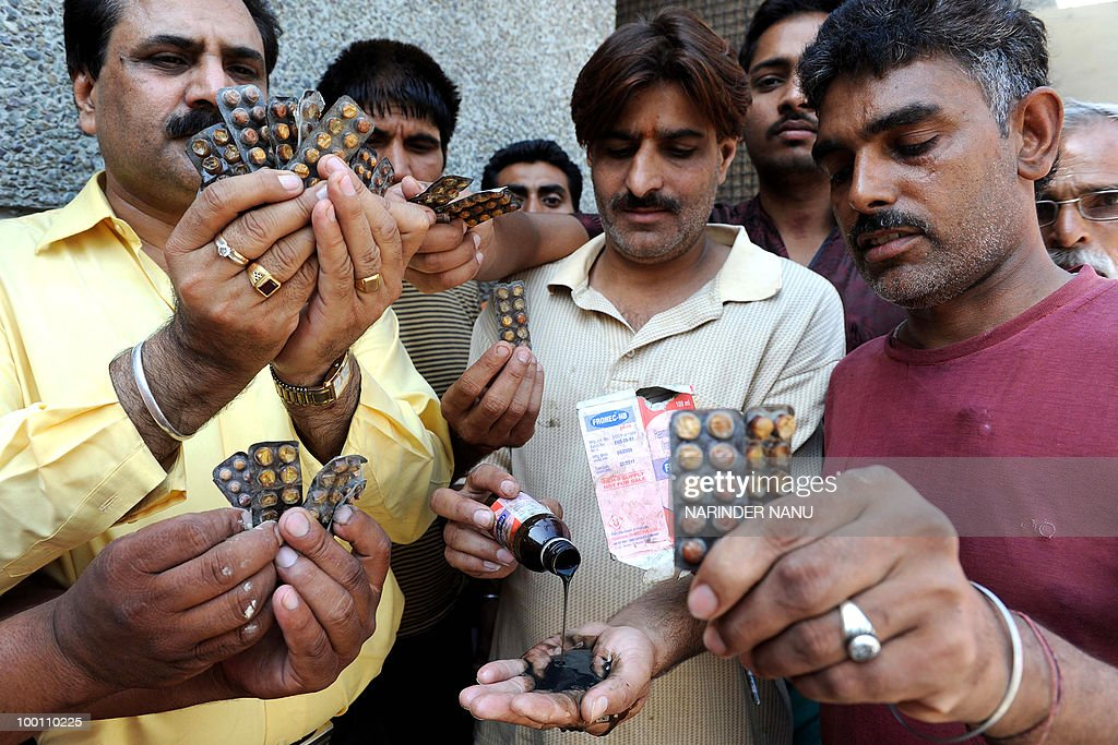 Indian social workers display medicine of allegedly poor quality outside the Civil hospital in Amritsar on May 21, 2010 . Twenty three students of a Government Secondary School were admitted to the Civil hospital after taking calcium and iron tablets distributed by school staff supplied by the National Rural Health Mission.
