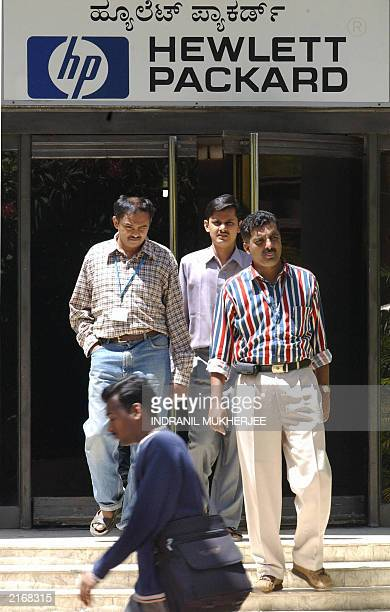 Indian software professionals walk out from the office of USbased Hewlett Packard in Bangalore 12 June 2003 According to industry officials...