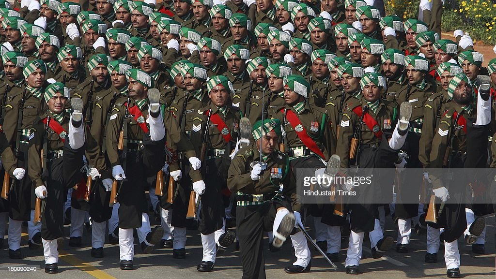 Indian Soldier marching contingents salutes the President of India Pranab Mukherjee during the 64th Republic Day parade celebration at Raj path on January 26, 2013 in New Delhi, India. India marked its Republic Day with celebrations held under heavy security, especially in New Delhi where large areas were sealed off for an annual parade of military hardware.