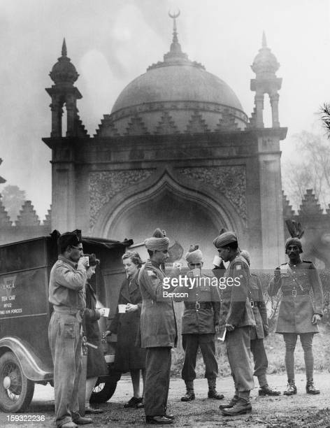 Indian soldiers drinking tea from a mobile canteen outside the Shah Jahan Mosque in Woking Surrey during World War II 28th November 1941