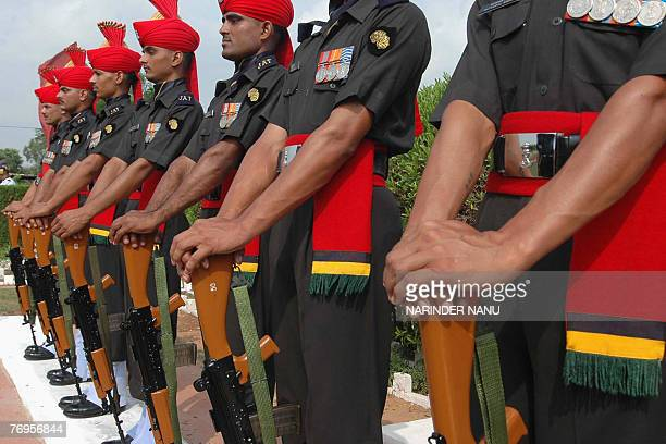 Indian soldiers from the 54th Infantry Brigade stand with their weapons reversed at Dograi War Memorial Khasa Military Stationsome 15kms from...