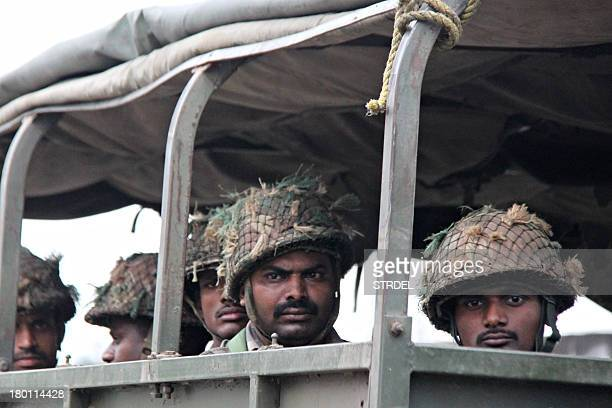 Indian soldiers look on from a military vehicle during a patrol following communal riots between Muslims and Hindus in Muzaffarnagar India's Uttar...