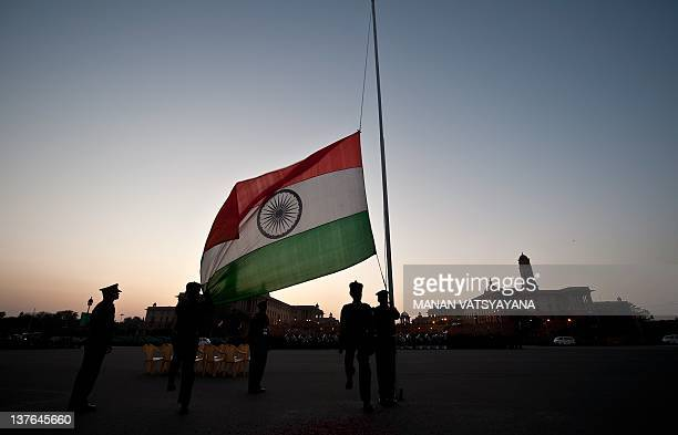 Indian soldiers lower the national flag after a rehearsal for the 'Beating the Retreat' ceremony in New Delhi on January 24 2012 ahead of the India's...