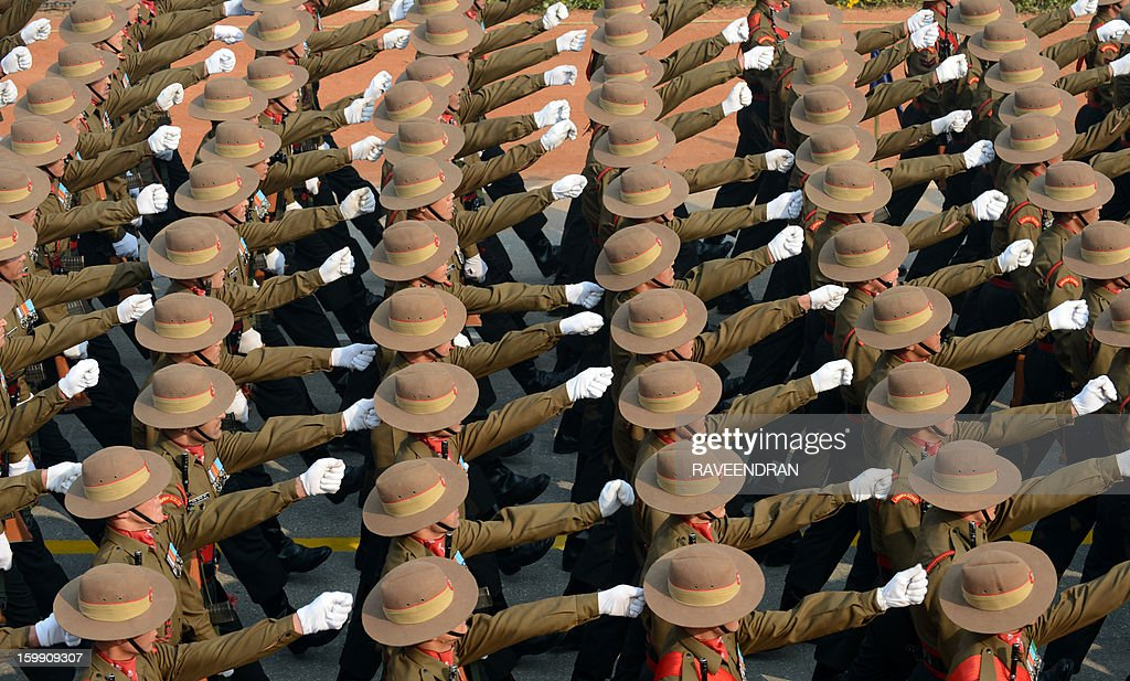 Indian soldiers march down Rajpath during the final full dress rehearsal for the Indian Republic Day parade in New Delhi on January 23, 2013. India will celebrate the 64th Republic Day on January 26 with a large military parade. AFP PHOTO/ RAVEENDRAN