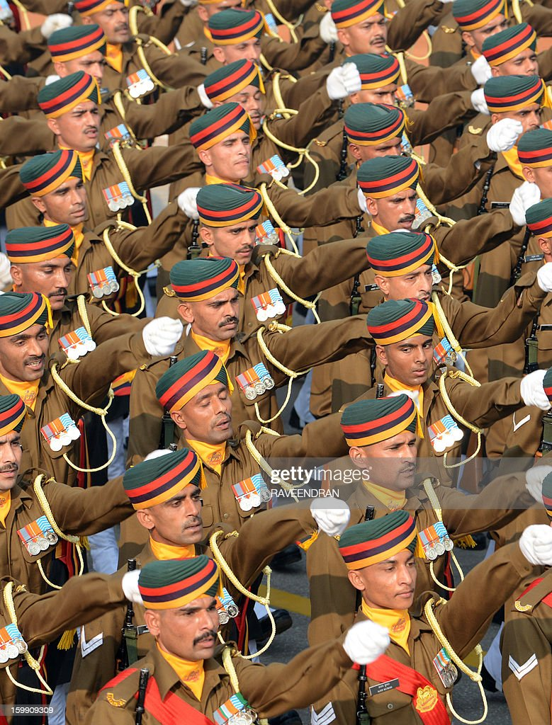 Indian soldiers march down Rajpath during the final full dress rehearsal for the Indian Republic Day parade in New Delhi on January 23, 2013. India will celebrate the 64th Republic Day on January 26 with a large military parade.