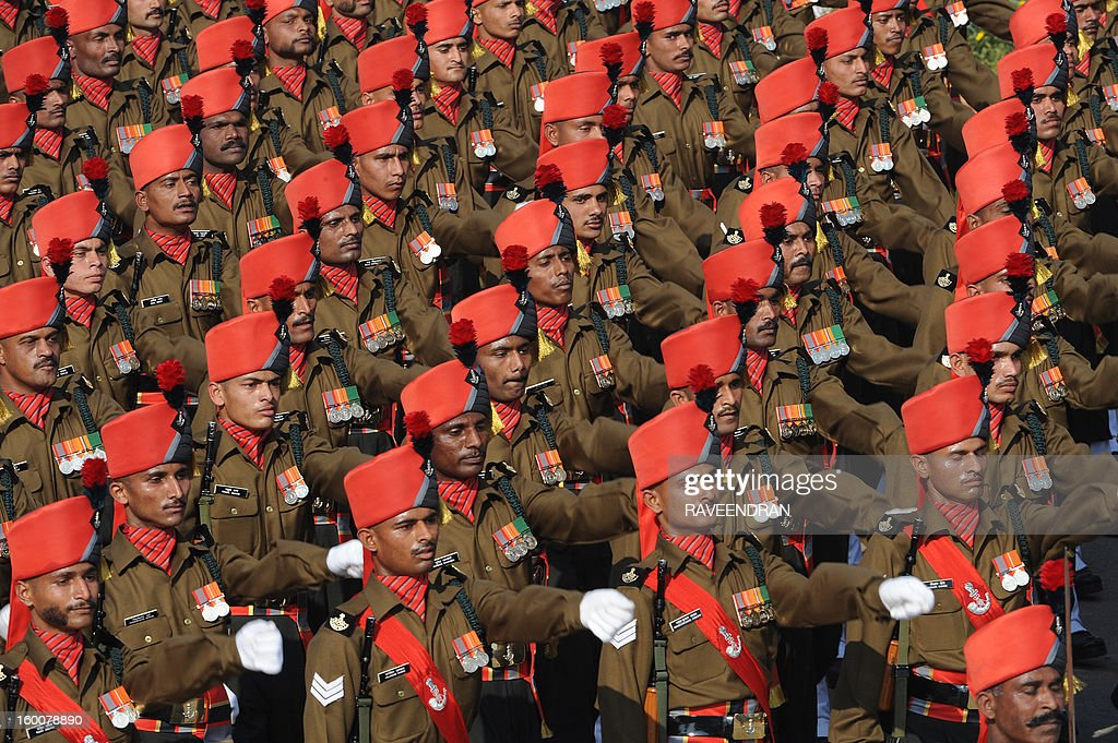 Indian soldiers march down the ceremonial boulevard Rajpath during the Republic Day parade in New Delhi on January 26, 2013. India marked its Republic Day with celebrations held under heavy security, especially in New Delhi where large areas were sealed off for an annual parade of military hardware at which Bhutan's king Jigme Khesar Namgyel Wangchuck was chief guest.