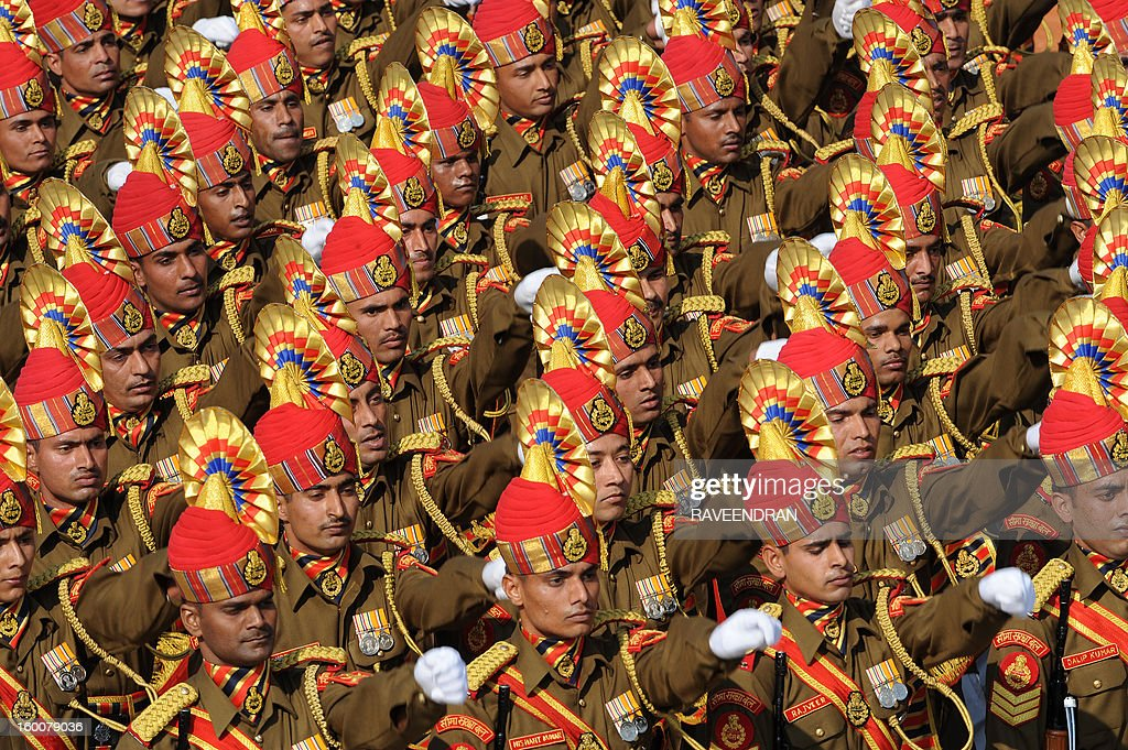 Indian soldiers march down the ceremonial boulevard Rajpath during the Republic Day parade in New Delhi on January 26, 2013. India marked its Republic Day with celebrations held under heavy security, especially in New Delhi where large areas were sealed off for an annual parade of military hardware at which Bhutan's king Jigme Khesar Namgyel Wangchuck was chief guest. AFP PHOTO/RAVEENDRAN