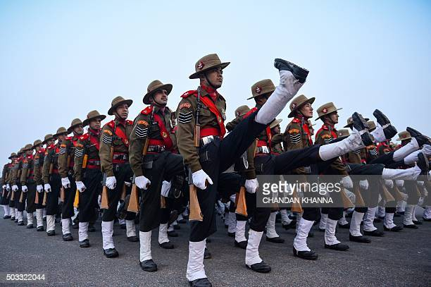 Indian soldiers of the Assam Rifles march during a rehearsal for the forthcoming Republic Day parade on a foggy winter morning at Rajpath in New...