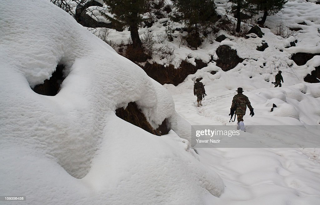 Indian soldiers patrol in about five feet of snow in Churunda village on January 12, 2013, northwest of Srinagar, the summer capital of Indian Administered Kashshmir, India. The village with a population of a little over 12,000 people has been bearing the brunt of cross-fire between nuclear rivals India and Pakistan. Last week a Pakistan solider was killed across the Line of Control (LOC), a military line that divides Indian-administered Kashmir from the Pakistan-administered Kashmir at this village. People living along the LoC have continually been at risk due to hostility between the armies of the two rival nations. Last year, in November, three people, including a pregnant woman, had died after a shell fired from Pakistan landed on one of the houses in the village. Tension between Pakistan and India has escalated after a fresh skimirish along the border. Both countries have summoned each other's envoy to protest against unacceptable and unprovoked' attacks.