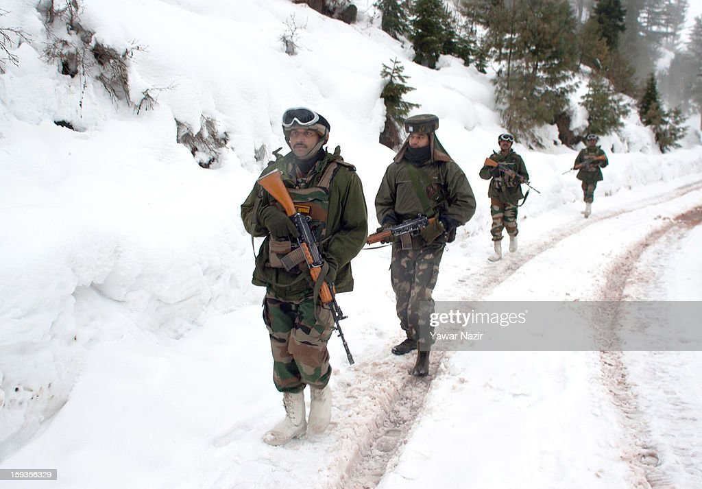 Indian soldiers patrol through about five feet snow in Churunda village on January 12, 2013, northwest of Srinagar, the summer capital of Indian Administered Kashshmir, India. The village with a population of a little over 12,000 people has been bearing the brunt of cross-fire between nuclear rivals India and Pakistan. Last week a Pakistan solider was killed across the Line of Control (LOC), a military line that divides Indian-administered Kashmir from the Pakistan-administered Kashmir at this village. People living along the LoC have continually been at risk due to hostility between the armies of the two rival nations. Last year, in November, three people, including a pregnant woman, had died after a shell fired from Pakistan landed on one of the houses in the village. Tension between Pakistan and India has escalated after a fresh skimirish along the border. Both countries have summoned each other's envoy to protest against unacceptable and unprovoked' attacks.
