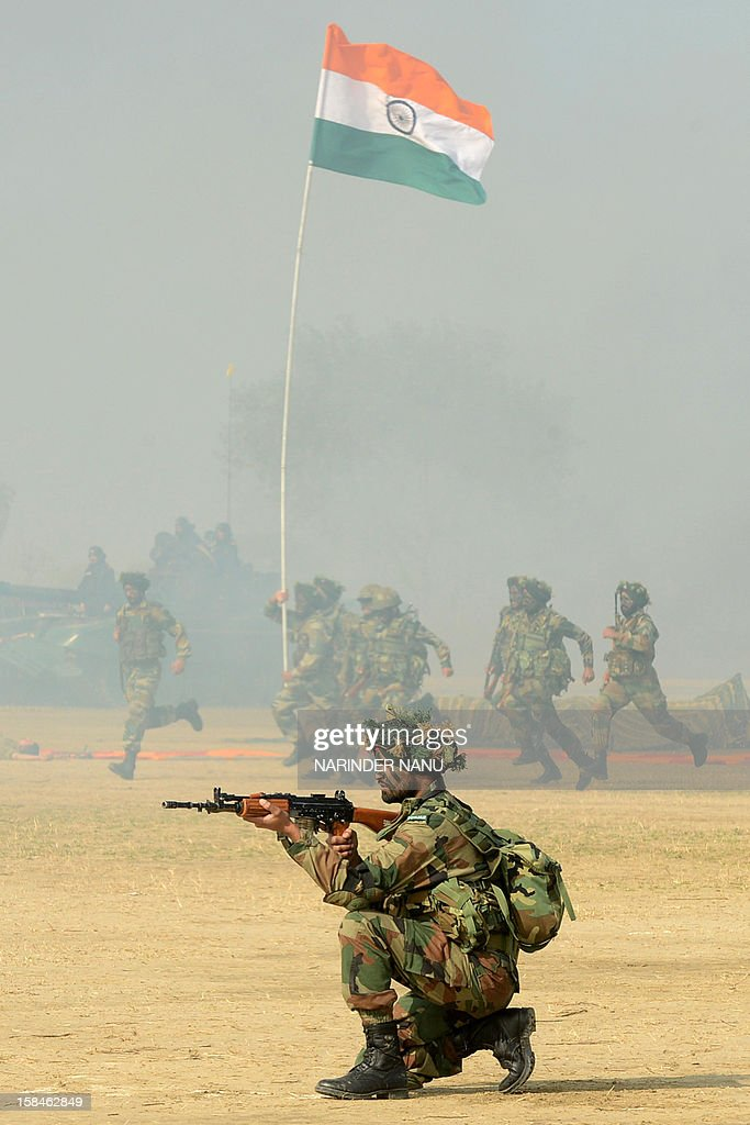 Indian soldiers perform a demonstration drill during an Army Mela (fair) and exhibition at Khasa, some 15 kms from Amritsar, on December 17, 2012. The Army Mela (fair ), organised by the Vajra Corps, displayed weapons, tanks, aircraft and military equipment to students and civilian visitors of the event.