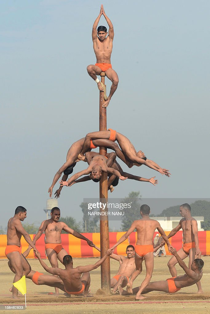Indian soldiers perform the mallakhamb during an Army Mela (fair) and exhibition at Khasa, some 15 kms from Amritsar, on December 17, 2012. The Army Mela (fair ), organised by the Vajra Corps, displayed weapons, tanks, aircraft and military equipment to students and civilian visitors of the event. AFP PHOTO/ NARINDER NANU