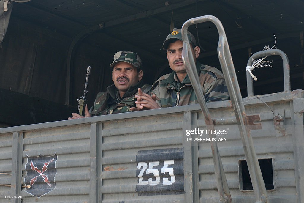 Indian soldiers ride in a military truck as they move towards a camp in Jammu on January 10, 2013. The beheading of an Indian soldier may have sparked a war of words between Delhi and Islamabad but the two nuclear rivals are both determined to prevent it from wrecking a fragile peace process. Two Indian soldiers died after a firefight erupted in disputed Kashmir on Tuesday as a patrol moving in fog discovered Pakistani troops about 500 metres (yards) inside Indian territory, according to the Indian army. AFP PHOTO/Tauseef MUSTAFA
