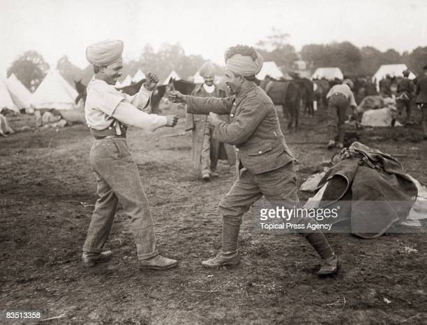 Indian soldiers serving with the British Army engage in a friendly boxing match circa 1916