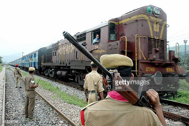Indian soldiers stand guard at a railway track as a train arrives near an oil refinery outside Guwahati the capital of India's northeastern state of...