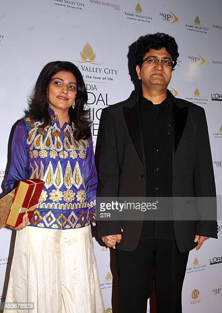 Indian songwriter and screenwriter Prasoon Joshi with wife Aparna attends the 'Aamby Valley India Bridal Fashion Week 2013' fashion show in Mumbai on...