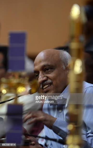 Indian Space Research Organisation Chairman Kirankumar Reddy gestures during a press conference after the launch of communication Satellite GSAT19 on...