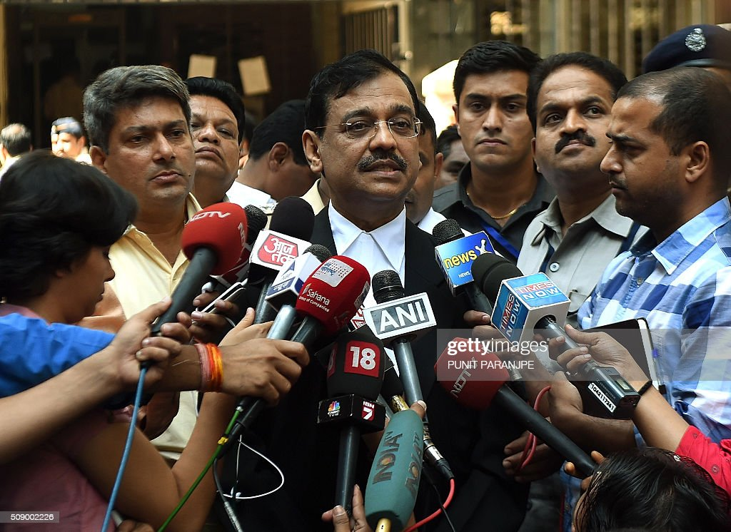 Indian Special public prosecutor Ujjwal Nikam (C) speaks to the media outside the sessions court in Mumbai on February 8, 2016. An American who helped plot the Mumbai attacks told a court via video call on February 8 that Pakistan-based militants made two failed attempts on the Indian city before killing 166 people in November 2008. David Headley, who is serving 35 years in a United States prison for his role in the atrocity, said Lashkar-e-Taiba (LeT) militants had been behind the attacks eight years ago. AFP PHOTO / PUNIT PARANJPE / AFP / PUNIT PARANJPE