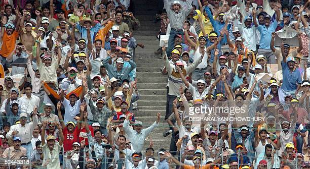 Indian spectators celebrate the dismissal of Pakistan captain InzamamulHaq for 30 during the third day of the second Test of the IndoPakistan 2005...