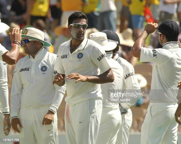 Indian spin bowler Ravi Ashwin is congratulated by teamates after bowling Australian batsman Shaun Marsh on day 1 of the fourth cricket Test match...