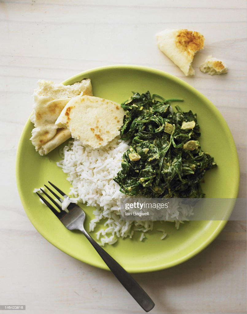 indian spinach saag with basmati rice and nan : Stock Photo