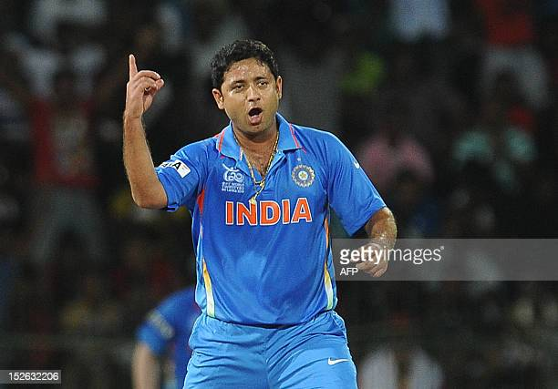 Indian spinner Piyush Chawla celebrates after he dismissed England cricketer Jonathan Bairstow during the ICC Twenty20 Cricket World Cup match...