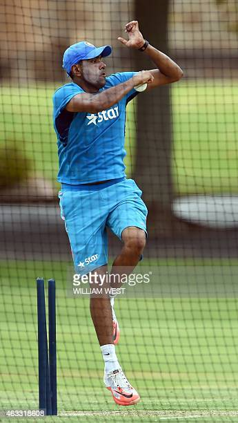 Indian spinner Ravi Ashwin bowls in the nets during a cricket training session in Adelaide on February 13 2015 ahead of their opening match against...