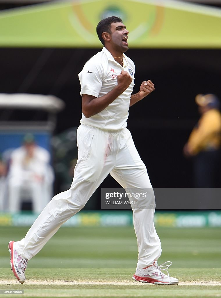 Indian spinner Ravi Ashwin celebrates after dismissing Australian batsman David Warner during the fourth day of the third cricket Test match against...